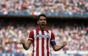 Atletico Madrid's Garcia celebrates after scoring a goal against Villarreal during their La Liga soccer match in Madrid